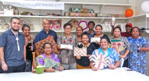 Bank of Marshall Islands President Patrick (center holding bag of Ebon flour) joined with Arlington Tibon (third from left), Marshall Islands Service Corporation and BOMI staff at the opening of the new Local Market in Uliga. Photo: Hilary Hosia.