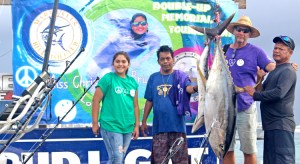 Christal deBrum was on hand to welcome back fishermen to RRE Shoreline Dock last Saturday for the MBC Miss Christa's Memorial, including Team Jaqueline (captained by Melven Aliven, right) with their winning yellowfin tuna. Photo: Rebecca Lathrop.
