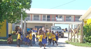 Students outside the Delap Elementary School campus in Majuro. Former DES and Rita Elementary Principal Baldwin Robert is taking on supervision of a big school improvement program for the Public School System.