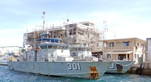 Kiribati's Teanoai patrol vessel with Sea Patrol's Lomor at RMI Sea Patrol Dock in Majuro earlier this month. At the back, Marshall Islands Marine Resources Authority's new three-story headquarters begins to take shape. Photo: Hilary Hosia.