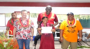 Marshalls Christian High School, located on the remote island of Rongrong in Majuro Atoll, completed a weeklong MIRCS-run first aid training, which ended with certificate ceremony joined by IFRC Secretary General Elhadj As Sy. In the photo, from left: MIRCS First Aid Trainer Harry Herming, MIRCS Secretary General Jack Niedenthal, first aid training graduate Asako Loeak showing off her certificate of completion, IFRC Secretary General Elhadj As Sy, and Majuro Mayor Ladie Jack. Photo: Roger Muller.