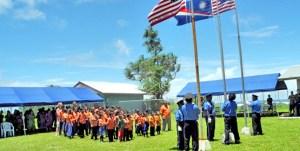 Raising flags on Ejit Island. Photo: Hilary Hosia.