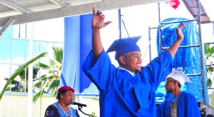 College of the Marshall Islands graduate Thurston Loeak celebrates after receiving his diploma at the May 31 graduation ceremony. Photo: Hilary Hosia.