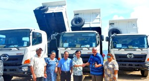 Japan Ambassador Hideyuki Mitsuoka handed over to Minister Tony Muller three dump trucks and spare parts for heavy equipment donated earlier, as other VIPs look on.