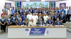 Athletes, coaches and administrators for Team RMI that competed at the Micronesian Games in Yap last month join with Nitijela members in a recognition ceremony Monday in the chamber. Photo: Hilary Hosia.