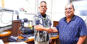A memorandum between V7AB Radio Marshall Islands and KMWR 98.9 FM Radio in Springdale, Arkansas was sealed by V7AB General Manager Antari Elbon (left) and KMWR 98.9 FM founder Larry Muller at the V7AB studio.