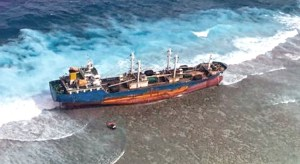 The fish carrier vessel Ou Ya Leng No. 6 hit the reef at Taka Atoll in the northern Marshall Islands January 3 and remains stuck there. Photo: US Coast Guard.