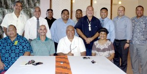 Marshall Islands Ports Authority board Chair Robert Pinho and Majuro Mayor Ladie Jack, seated center, signed an agreement for the two entities to work together. The event was witnesses by Majuro's five Nitijela members, and MALGov and Ports Authority representatives. Photo: Hilary Hosia
