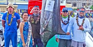 Captain Damien Milne, second from right, and his team fishing on Bakaro caught this 330 pound marlin on day one of the two-day Marshalls Billfish Club annual fishing tournament. The second day he caught the tournament-winning 415 pound marlin. Photo: Hilary Hosia.