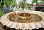 From a DLN article: Gene Gagliardi, in tan jacket, and his wife, Joan, look at a cast iron fountain they once owned as [Friends of Marshall Square Park] volunteers prepare to unload and return it to Marshall Square Park in West Chester on Monday, May 14, 2012. A committee is in the works to have it restored and placed back in the park after it was removed decades ago.