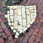 Project: Fountain. A shield of yellow bricks in honor of the Union Veteran Legion. Yes, needs attention. Photo: JAS September 16, 2005