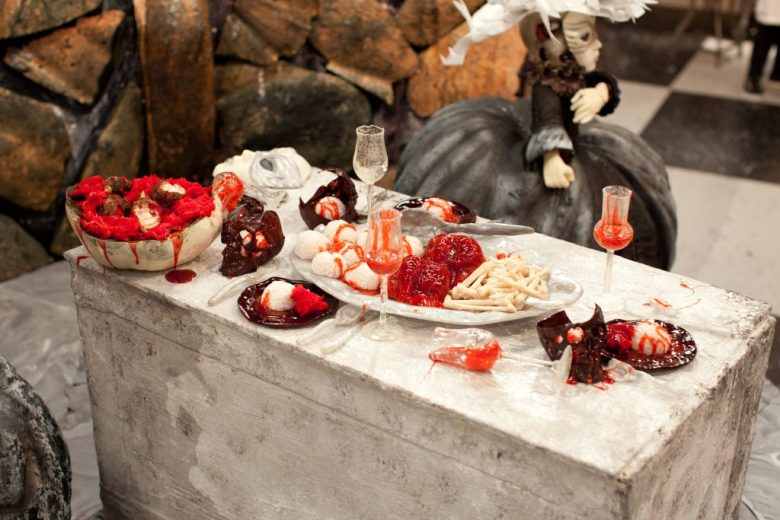 """A gory dinner appears atop a crypt in the Blue team's creation called """"Venetian Crypts"""" made during the final """"spine chiller"""" challenge, as seen on Food Network's Halloween Wars, Season 5."""