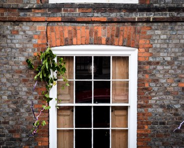 2016 Jack in the Green Red Brick Window Hanging Leaves small