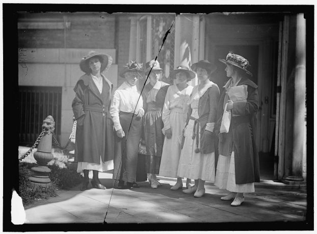 Women standing before the Women's Suffrage Headquarters waiting to begin their work.