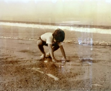 Vintage photo,, child playing in the sand