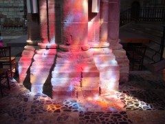 Colored light bathes the interior of Saint-Julien in Brioude, France., from Art in the Christian Tradition, a project of the Vanderbilt Divinity Library, Nashville, TN.