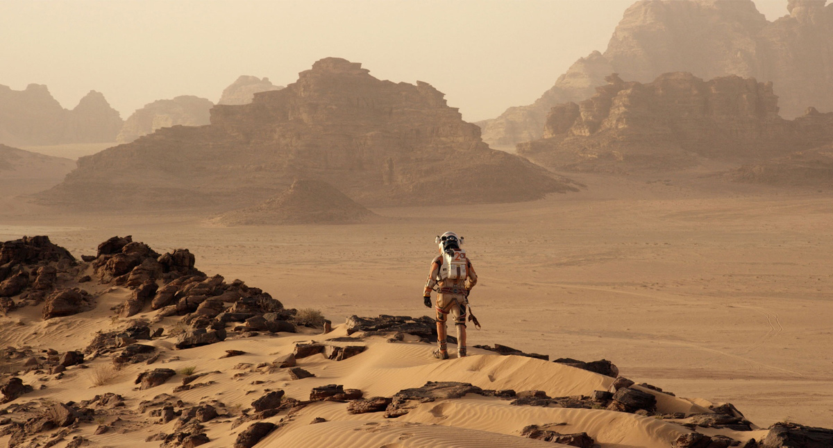 "Still from the movie ""The Martian"" showing Mark Watney on the surface."