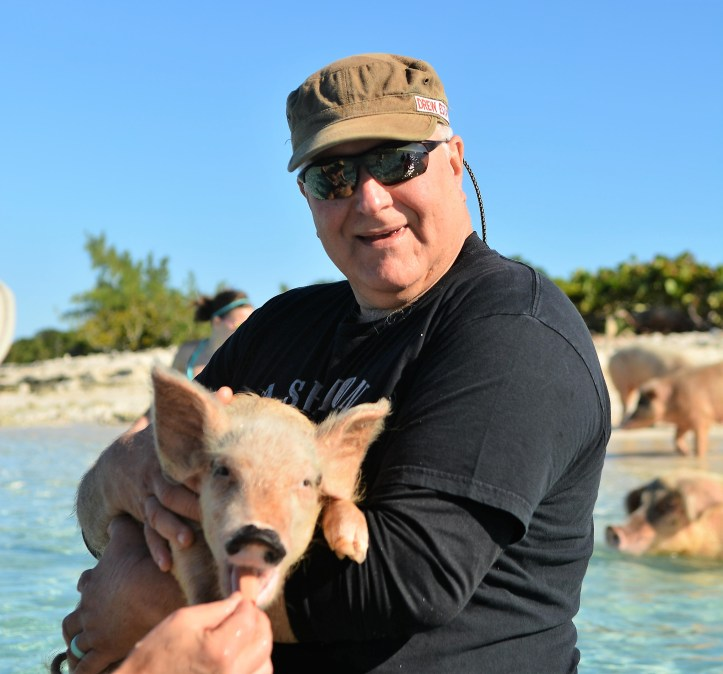 Robert Riesmeyer swimming with pigs crop