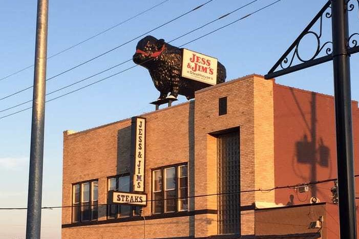 steakhouse roof and cow