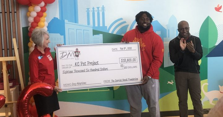 Chiefs player presents check to KC Pet Project for free pet adoptions