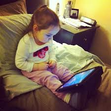 little girl watching ipad