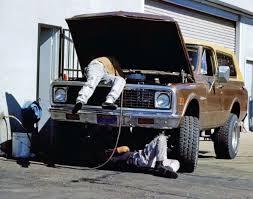 men working on car