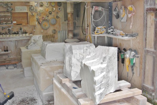 Colorado Yule Marble rough blocks upon each banker in the Birdhaven Studio Workshop, Woody Cree, Colorado