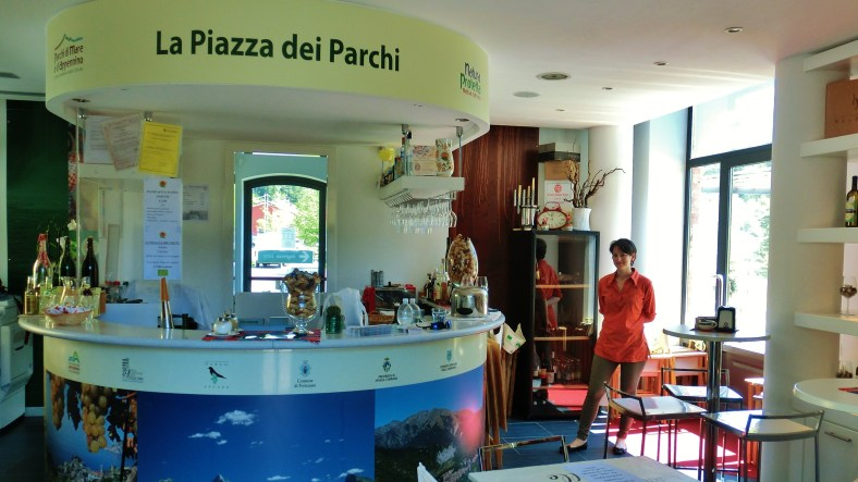 Information Center, store and coffee bar, La Piazza dei Parchi, Lunigiana, Tuscany, Italy