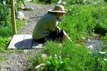 Kris Cooney enjoys a moment in the Colorado Rocky Mountain Sculpture Garden, Woody Creek CO, el 7,300 ft