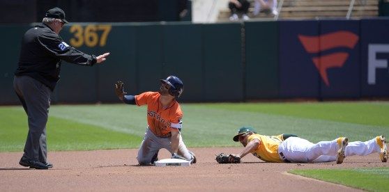 Oakland A's vs Houston Astros Jose Altuve steals second base Photos by Gerome Wright Martinez News-Gazette