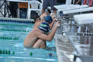 MCST Jackson Barnacal swimming backstroke at the Middle Ages Meet