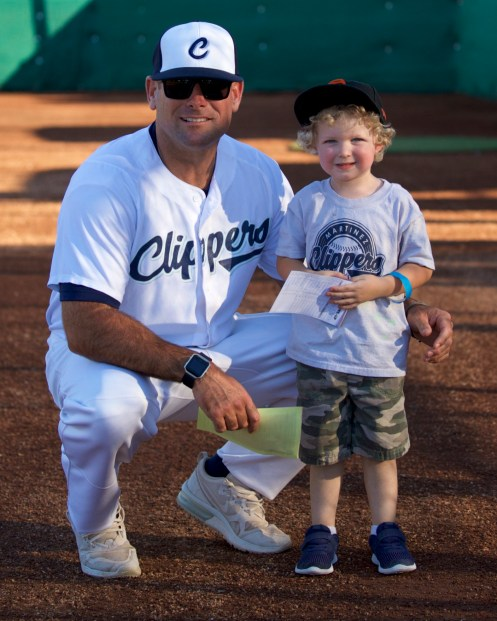 Martinez Clippers Fanfests Clippers Skipper Dan Parker with fan Keegan Moriarty Photo by Mark Fierner ( Martinez News-Gazette )