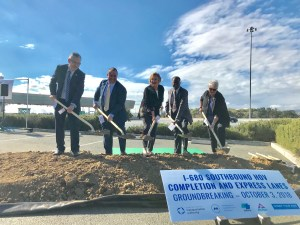 Local administrators  break ground for an express lane Wednesday north of the I-680 toll plaza.