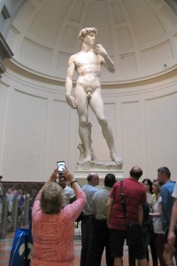 Sharon taking a picture of Michelangelo's statue of David.