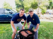 MIke Romano and Curtis Stahle. The Golden Bear BBQ Team demonstrating proper rib cooking technique.