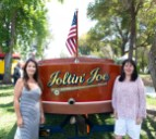 Passion to the Streets President Eve Cameron and Debbie McKillop, of the Martinez City Council pose with the Joltin Joe.
