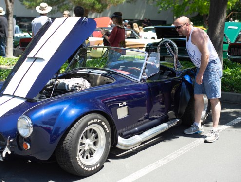 Martinez comedian Bob Johnston, admiring an AC Cobra 427, what he considers to be the most beautiful car ever made. He is a former '66 Mustang owner and big fan of Caroll Shelby.