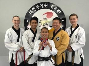 Hanna Lavino (center) holding her bronze medal