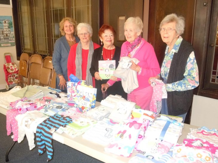 Priscilla Circle ladies of the Martinez Congregational Church display the  baby items from their 18th annual