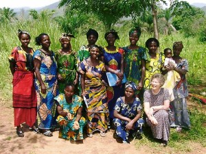 Hazel with members of the Women's Yearly meeting, in front of the Abeka field cultivated by widows as an income generating activity