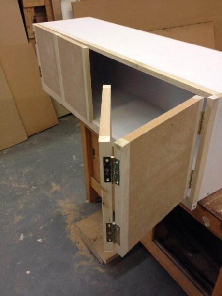 Bi fold doors on handmade cabinet