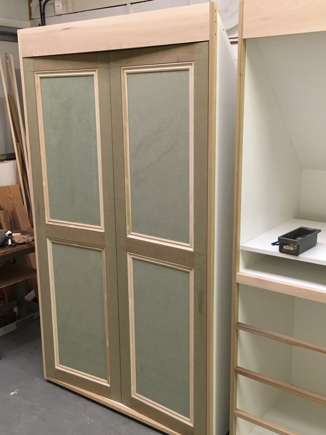Double wardrobe doors with applied moulding