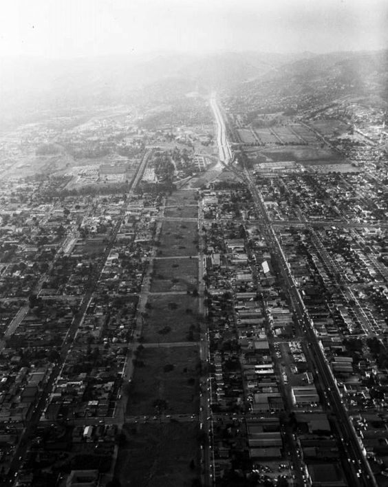 Aerial view of construction of the San Diego Freeway (405) is underway between Wilshire Blvd and Venice Blvd, Culver City 1957