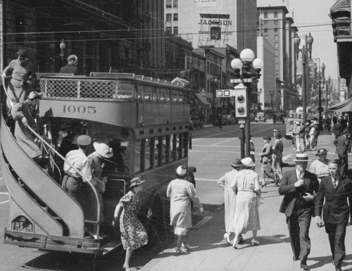 Double-decker bus at Olive St & West 7th St, Los Angeles, 1937.