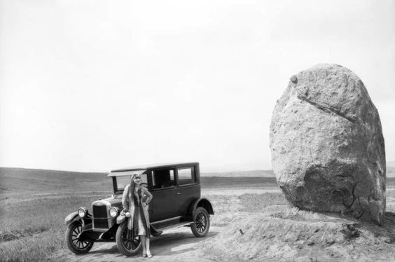 A woman, a Chevrolet, and Founders Rock at the future site of the UCLA Westwood campus, Los Angeles, 1926