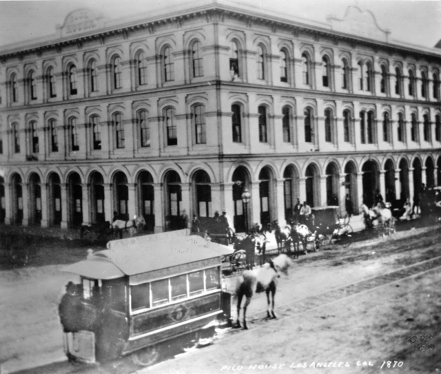 A horse-drawn streetcar on Main Street, downtown Los Angeles, in front of Pico House, 1870