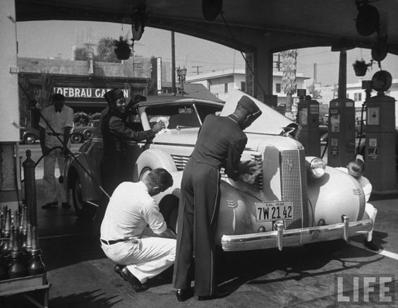 """An Auburn Cord being attended to in """"full service"""" at the Muller Brothers Service Station at 6380 Sunset Boulevard in Hollywood, 1938."""