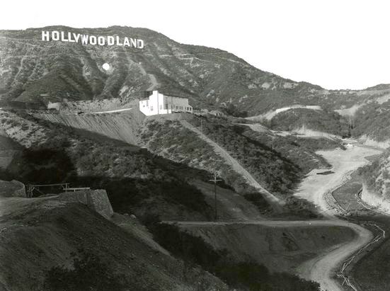 hollywoodland sign with dot hollywood hills with lone house circa