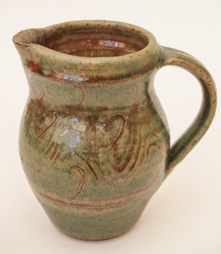 Ash glazed jug with copper slip decoration