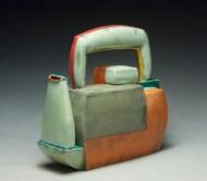 "Teapot. 2012. 9""h x 9""w x 5""d Hand built cone 03 earthenware, terra sigillata, underglaze, and glaze. Electric fired."